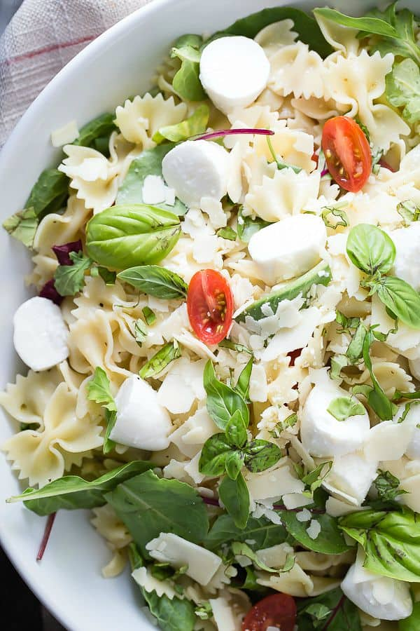 Fresh basil and greens in a tomato and mozzarella salad