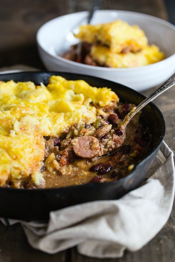 Rich thick stew with ground beef and andouille sausage tamale pie
