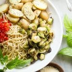 Pesto coated linguine with potatoes and roasted brussels sprouts.