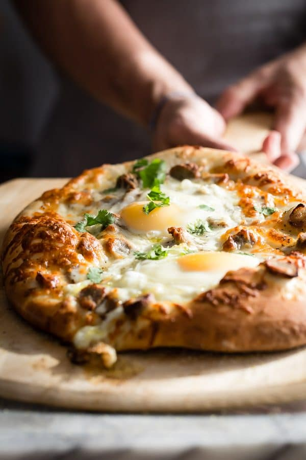 Chewy pizza dough topped with sausage cheese and egg makes this a great breakfast pizza choice