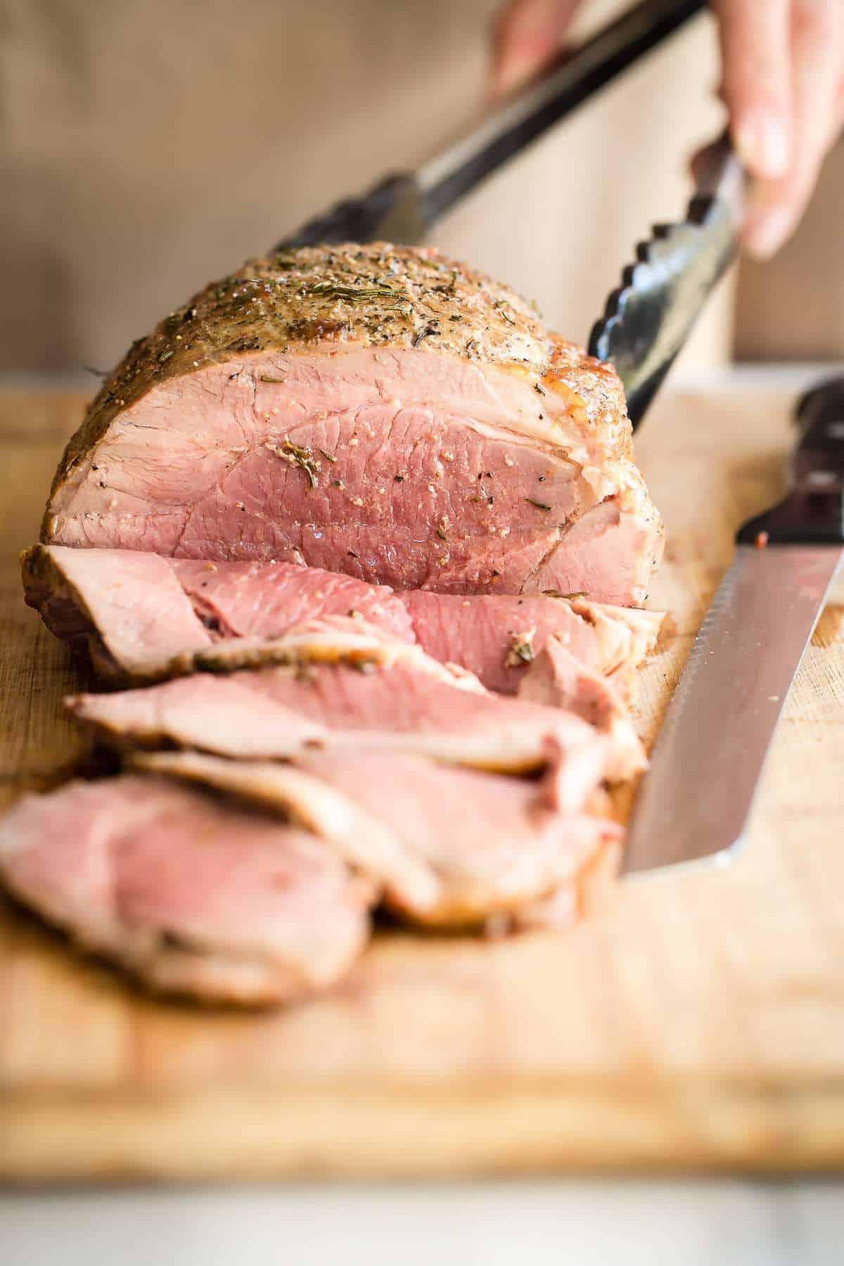 Juicy roast leg of lamb served with roasted root vegetables