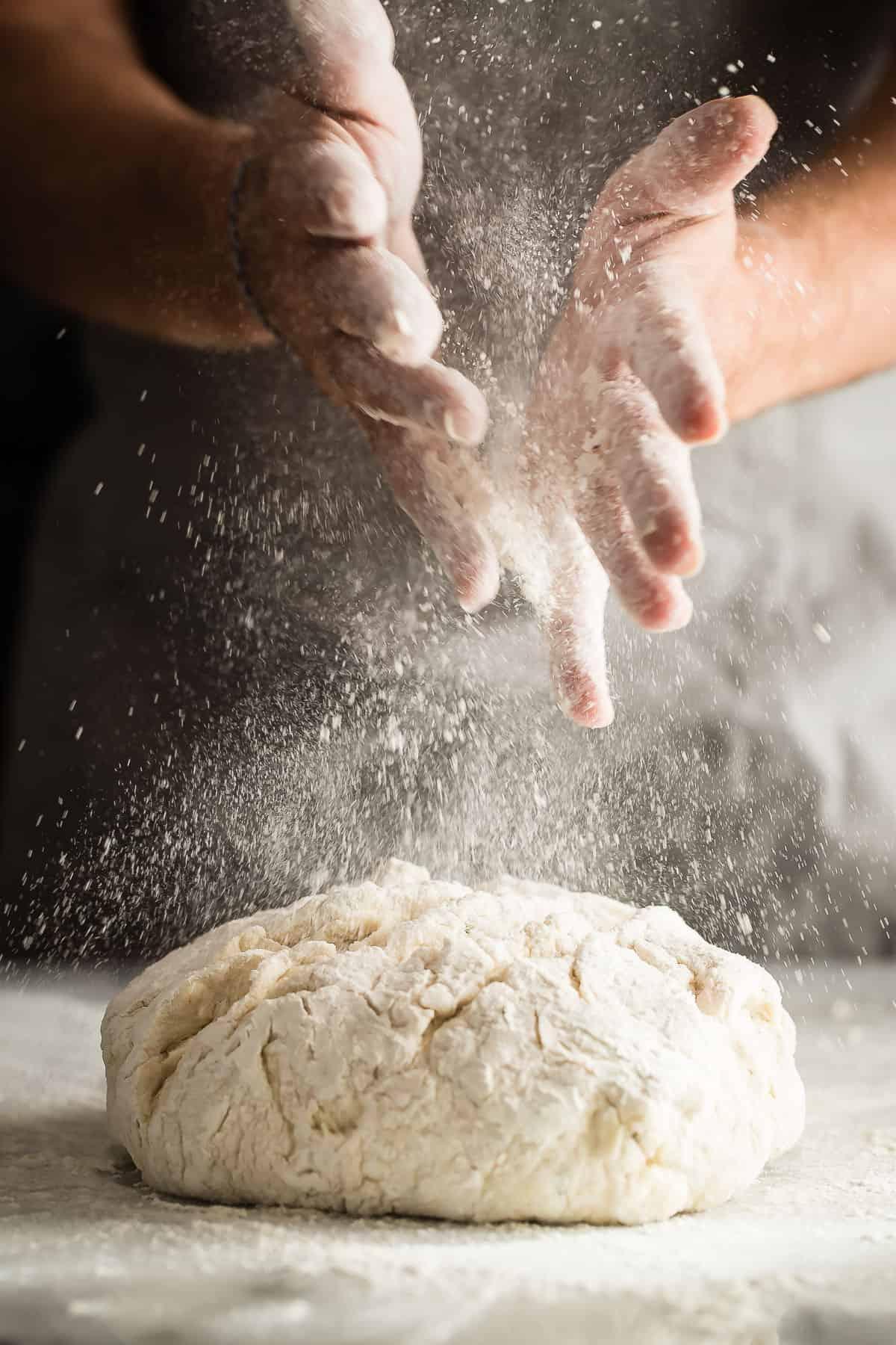 a ball of dough with flour