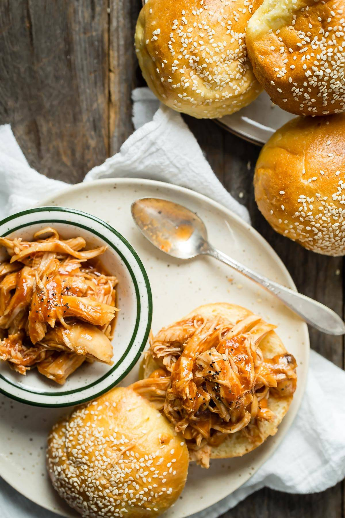 Slow cooker BBQ chicken sandwiches served in a soft brioche bun.