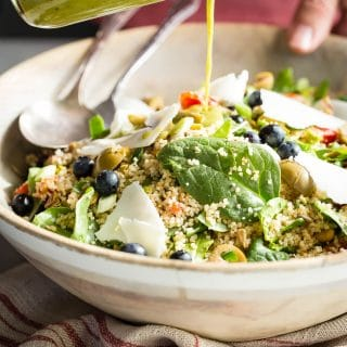 Couscous salad with fresh greens, roasted tomatoes tossed in a cilantro dressing