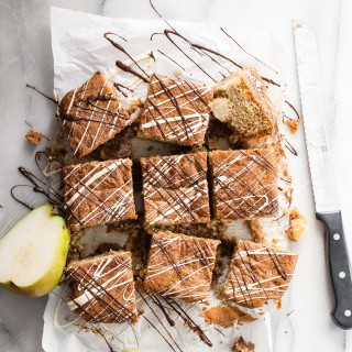 A moist gluten free coffee cake with swirls of blackberry jam and fresh pear