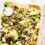 Tortilla chips, cheese sauce, ground taco meat, black beans, guacamole and creamy ranch make these nachos fully loaded.