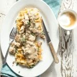 Crispy hash brown waffles covered in sweet Italian sausage gravy with sage and rosemary