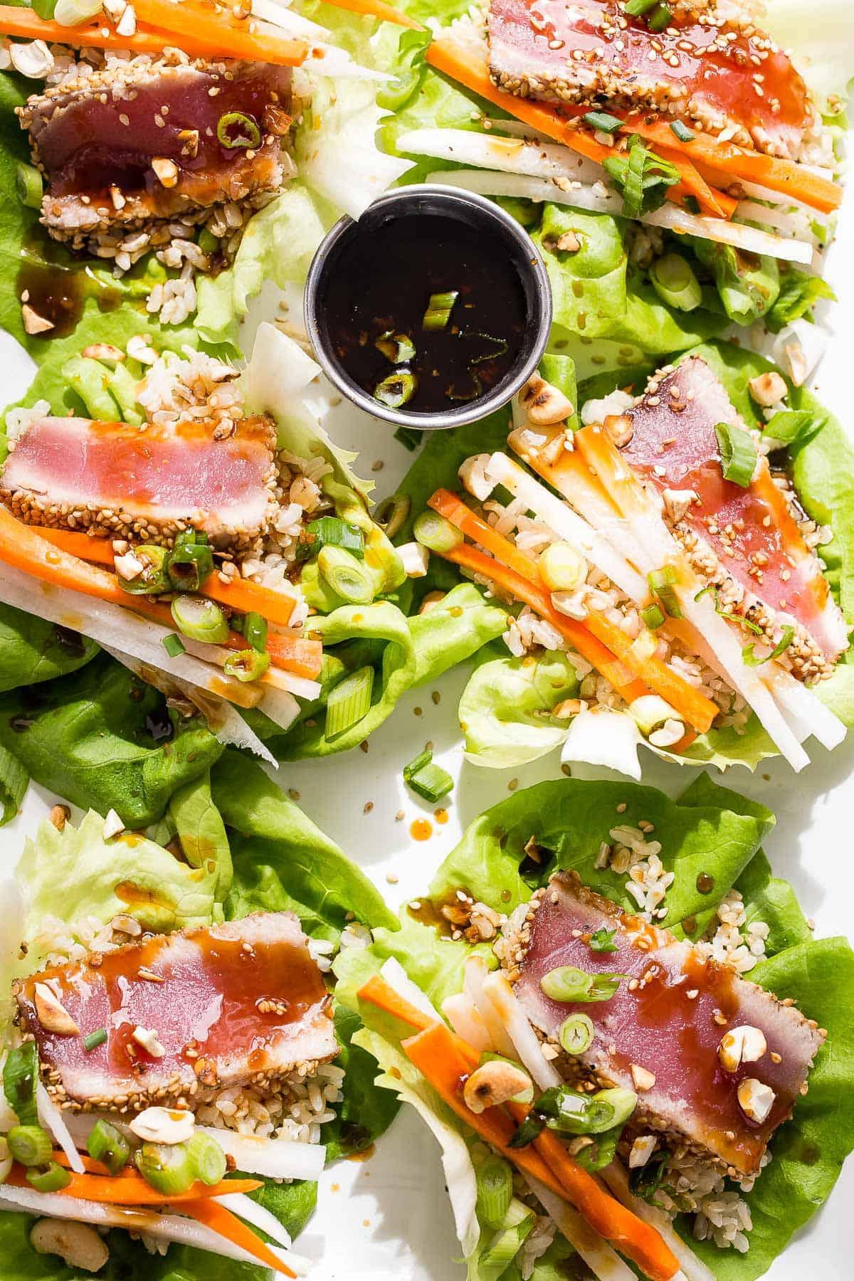 Sashimi grade seared ahi tuna with brown rice, daikon radish, carrots and topped with some homemade orange teriyaki sauce