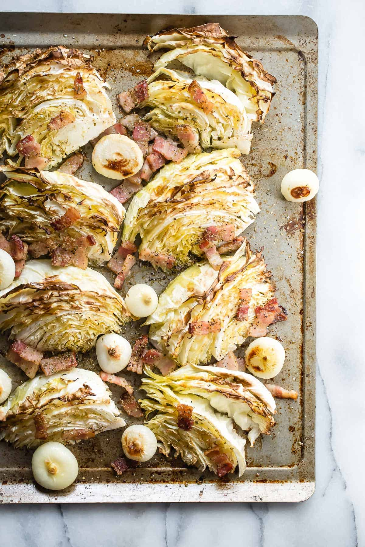 Roasted cabbage with chopped bacon bits, olive oil and cippolini onions. Perfect for St Patrick's Day