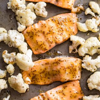 Roasted salmon filet with a wholegrain mustard and honey glaze, served with roasted cauliflower