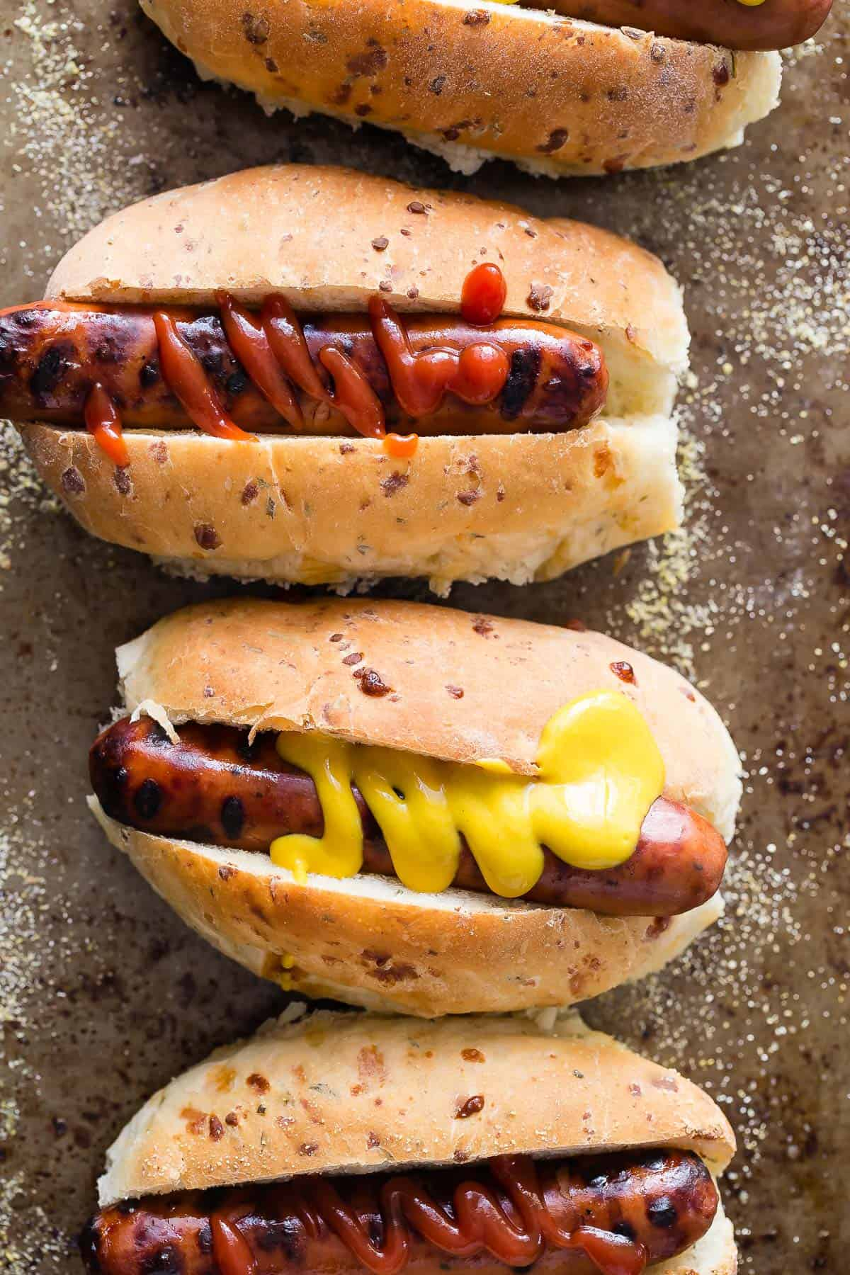 Soft homemade hot dog buns with cheddar and fresh rosemary.