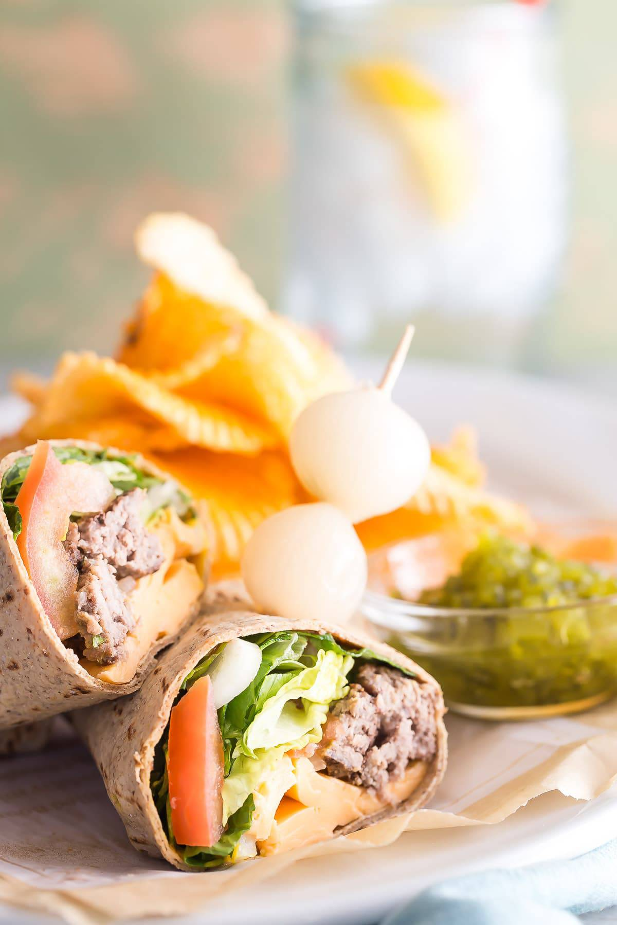 Skip the bun and use a wrap to make this easy cheeseburger sandwich wrap.