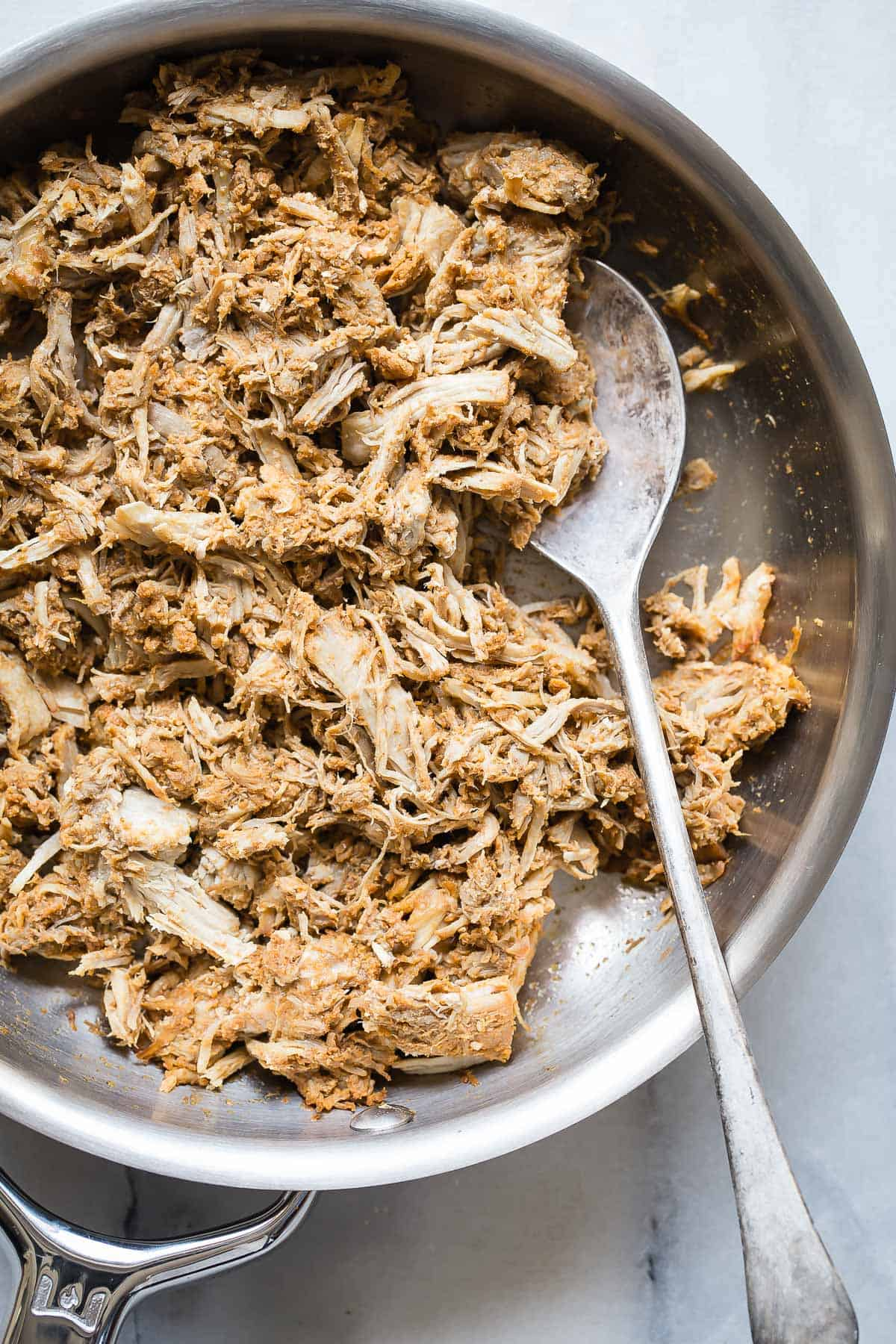 Shredded Pork in a pan with spoon