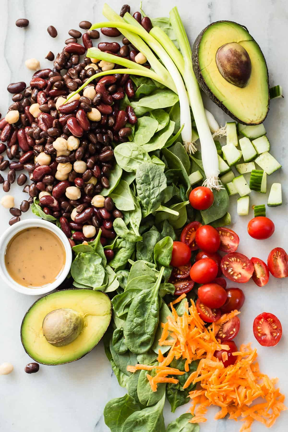 An awesome tasting Garden Bean Salad packed with three types of beans, spinach, avocado and dressed in an Asian style dressing.