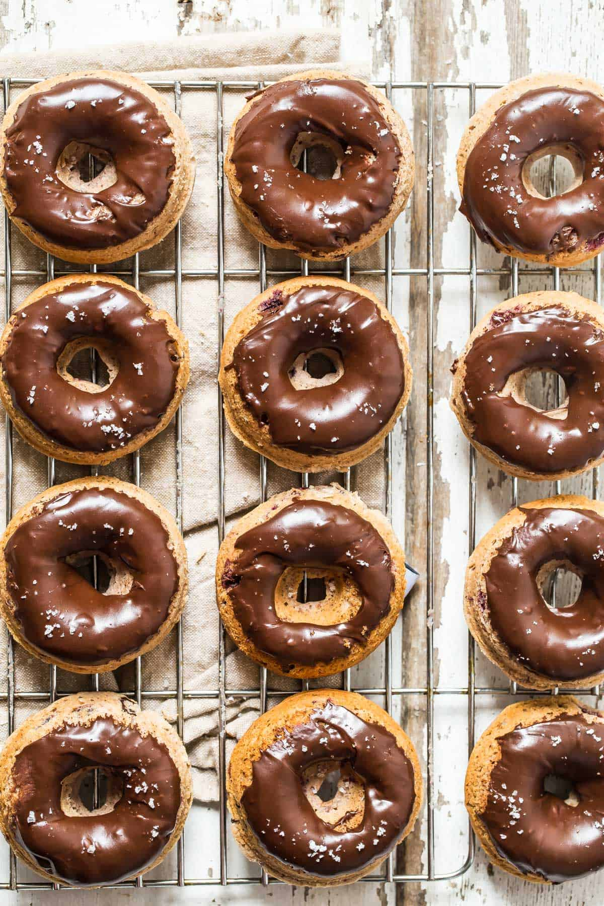 Homemade cherry and chocolate glazed baked donuts sprinkled with sea salt. The same sweet taste as fried but less mess.
