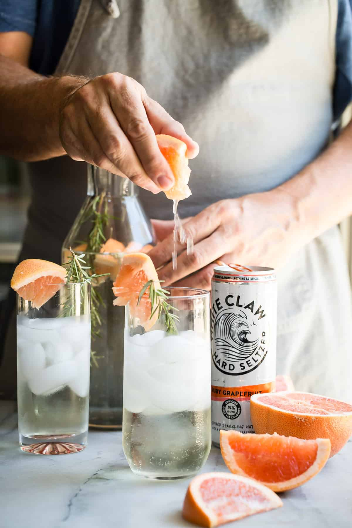 "Summer should be all about refreshing sparkling seltzer drinks like this White Claw Ruby Grapefruit Hard Seltzer, Prosecco and fresh rosemary. If I had to choose a ""hammock drink""...this would be it!"