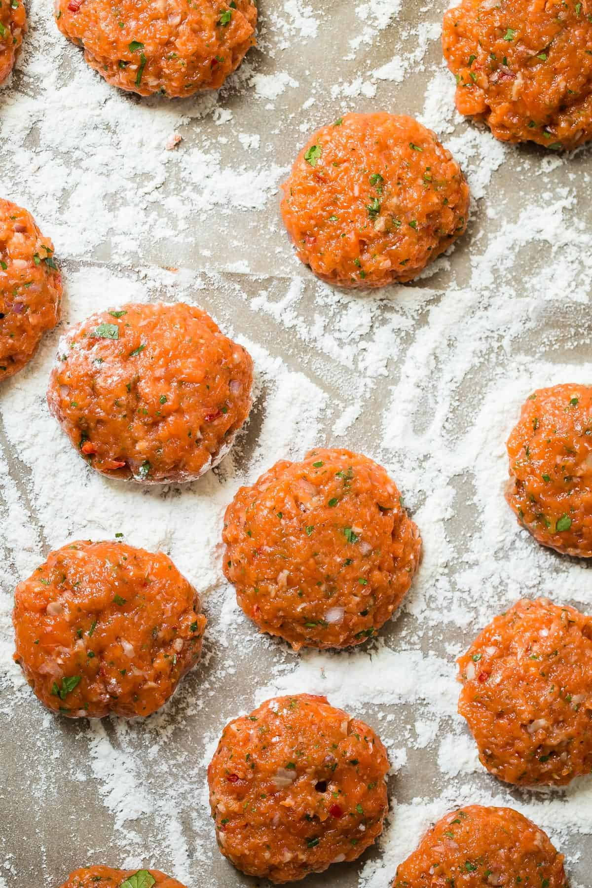 Fresh Alaskan Sockeye Salmon patties with a Thai influence. Make these mini patties as an appetizer or have them as mini seafood sliders! So easy to make!