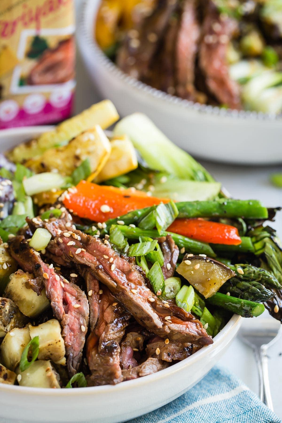 Grilled summer vegetables with World Harbors beef teriyaki skirt steak and healthy freekeh super-grain.