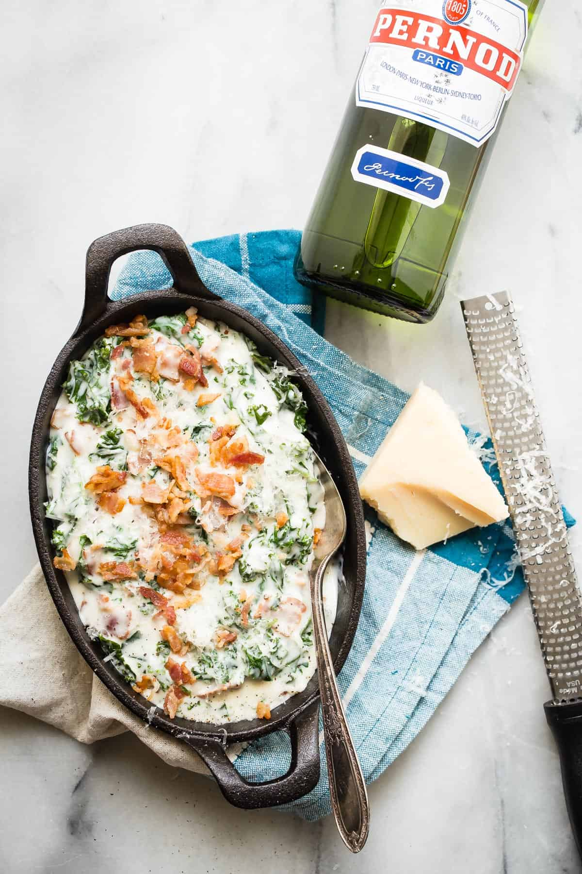 This Creamed Kale with Bacon and Parmesan cheese will easily make you forget about using spinach. Creamy with crunchy chunks of smoky bacon, this is a must-have side dish for the holidays!