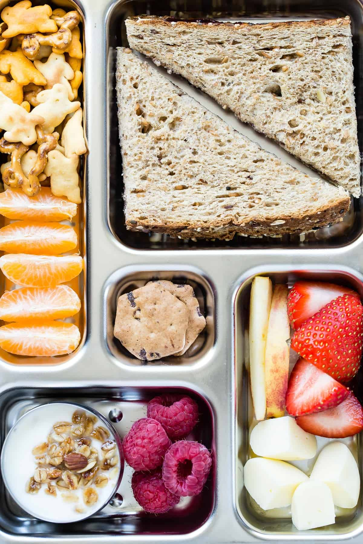 Making school lunch has never been easier with a PlanetBox lunch kit! No more messy lunch bags or using six different plastic containers to hold everything. There's so many amazing and tasty options available to fill each space.