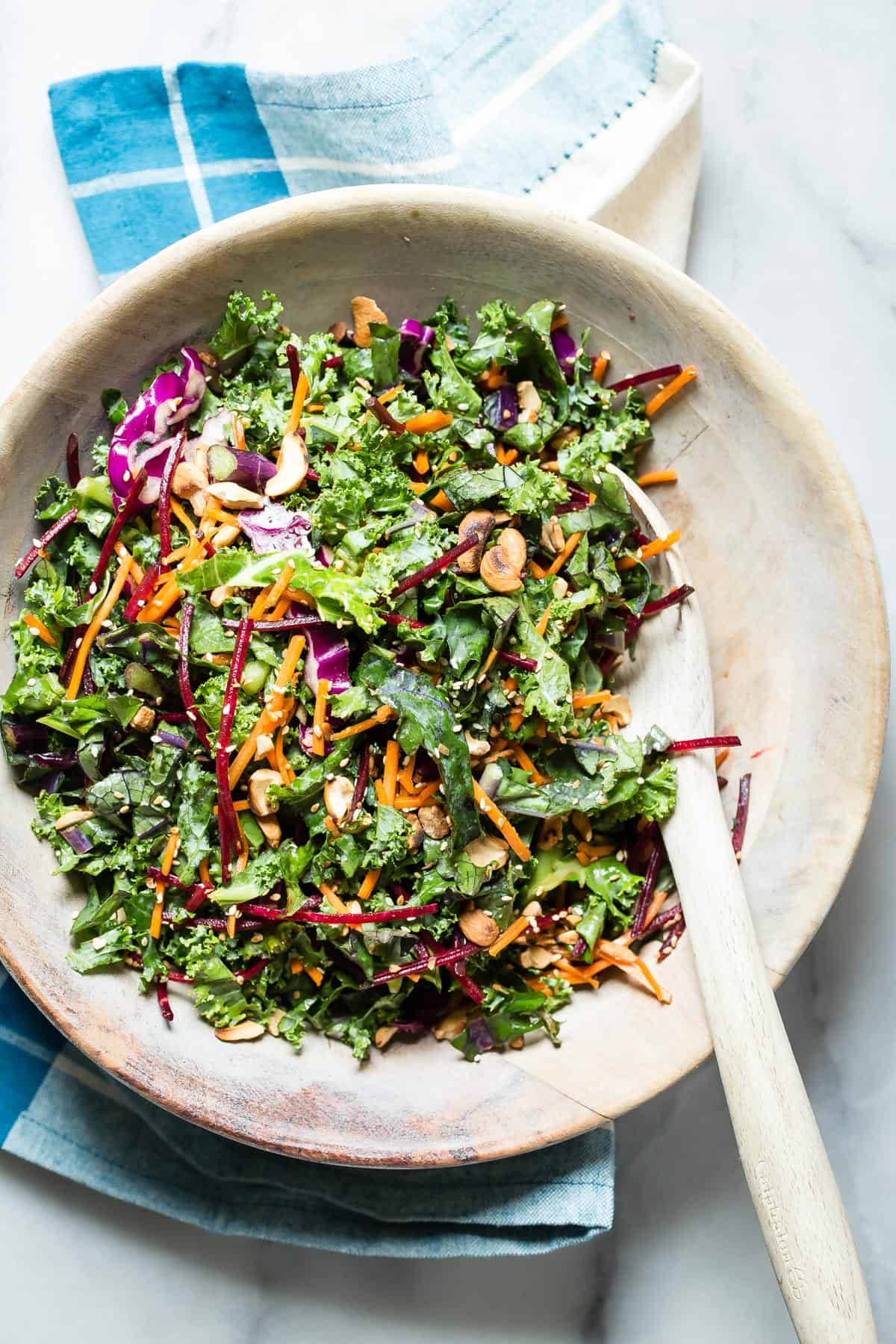 A super fresh and simple Kale Salad with shredded beet, red cabbage and carrots. I added marinated tofu chunks and grilled vegetables for an easy and healthy lunch.
