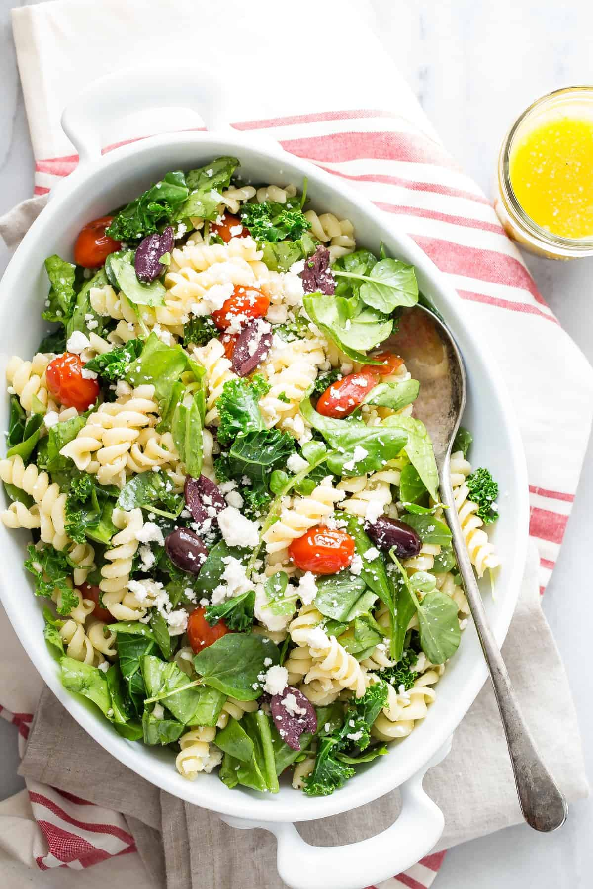 Rotini Pasta Salad with mixed greens, feta cheese, tomatoes and kalamata olives