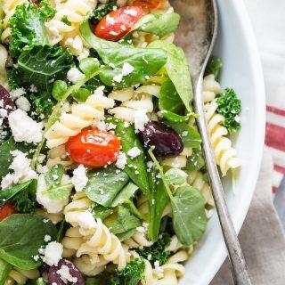 Rotini Pasta Salad with mixed greens, feta cheese, tomatoes and kalamata olives