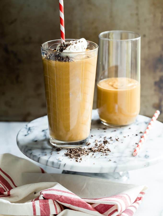 This Pumpkin Spice Smoothie is loaded with fall flavors and takes only minutes to make. With pumpkin, yogurt and apple cider, this smoothie will help get you through the holidays!