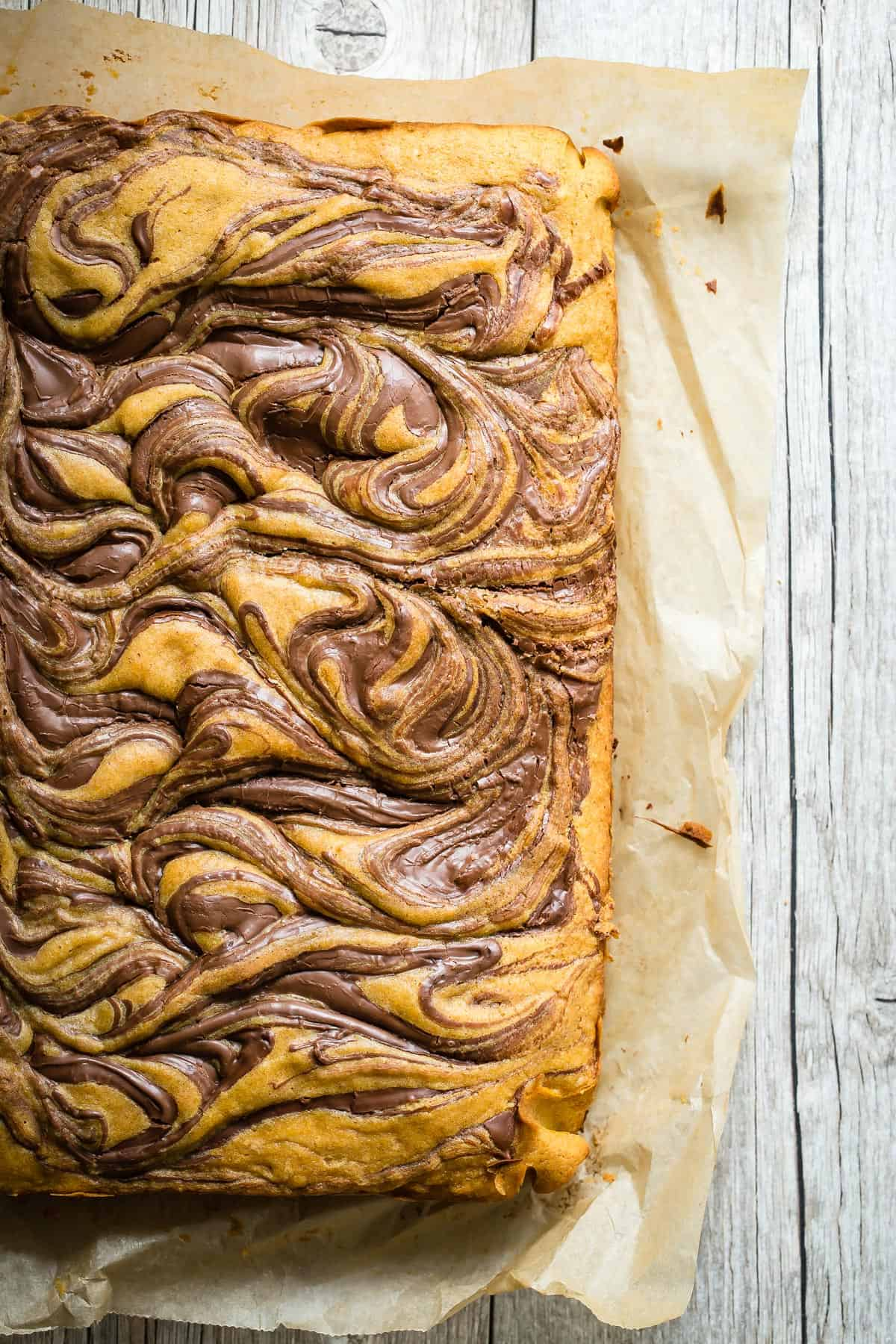 These Pumpkin Nutella Bars have the same consistency as a moist pumpkin bread, but with ribbons of creamy Nutella chocolate swirled through the batter! These won't hang around long after you make them.