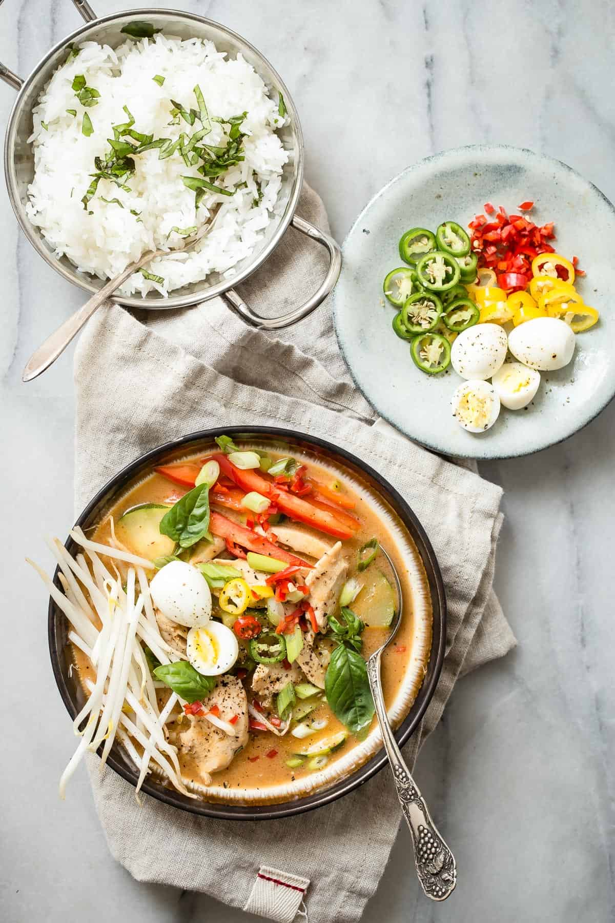 This Thai style Red Chicken Curry is just like the one I buy from my local Thai restaurant! Coconut milk with fish sauce and spices make it the perfect bath to cook some thin sliced chicken in. Add some sliced jalapeños if you like the heat!