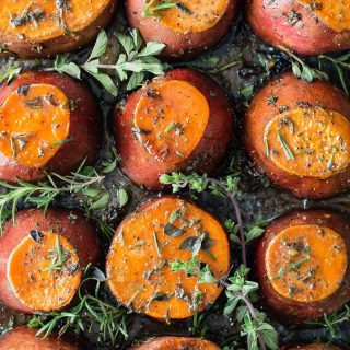 Roasted sweet potatoes with loads of butter, brown sugar and fresh chopped herbs. These end up caramelized and melty-soft, the perfect side to a pile of turkey on your plate this Thanksgiving