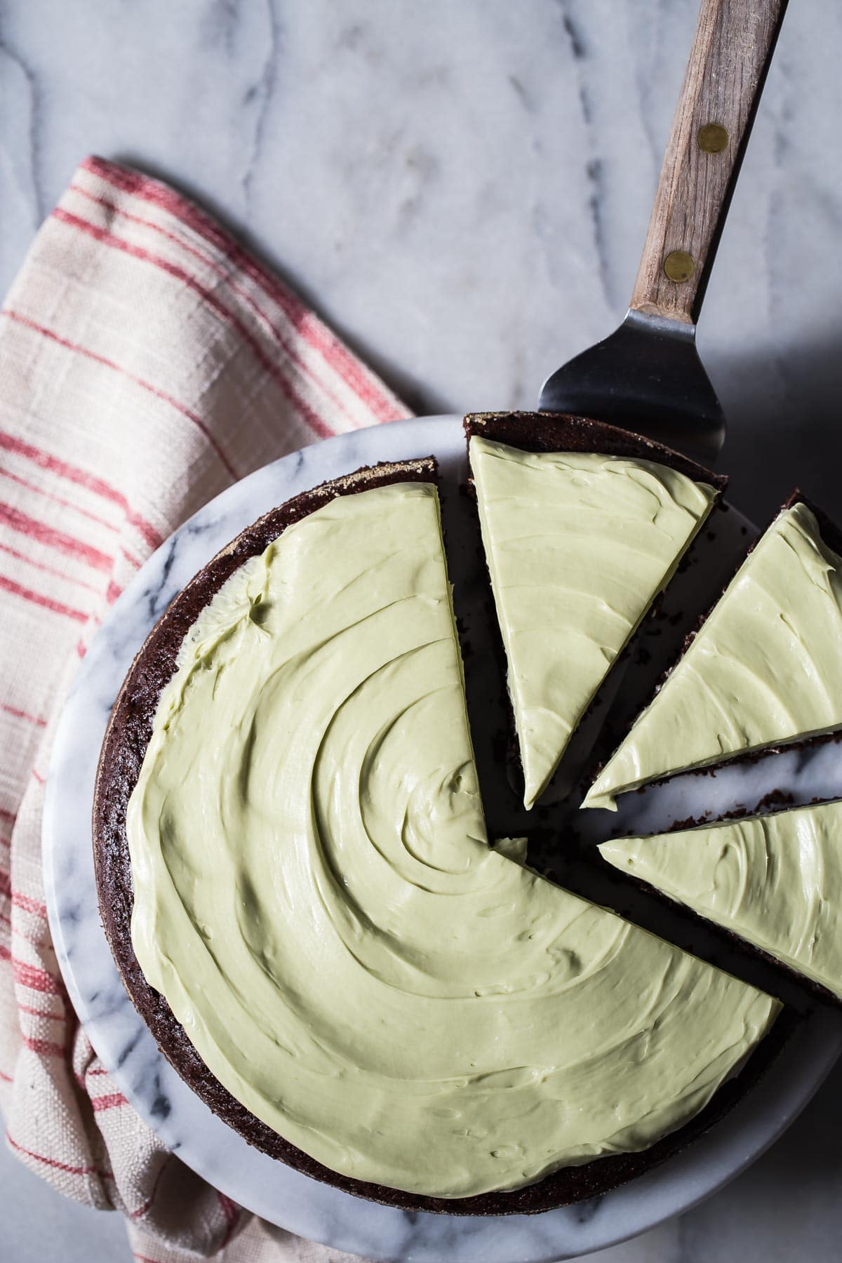 A rich dark chocolate zucchini cake covered in a sweet cream cheese matcha frosting. This cake is gluten free and tastes epic! Grab the recipe from Alternative Baker and show the world how you rock in the kitchen!