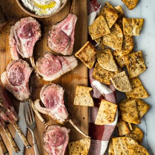 Lamb chops with lightly seasoned and served with a greek yogurt and Za'atar spice dip! Eat along with these super simple Flatout chips for an easy and spicy dinner!