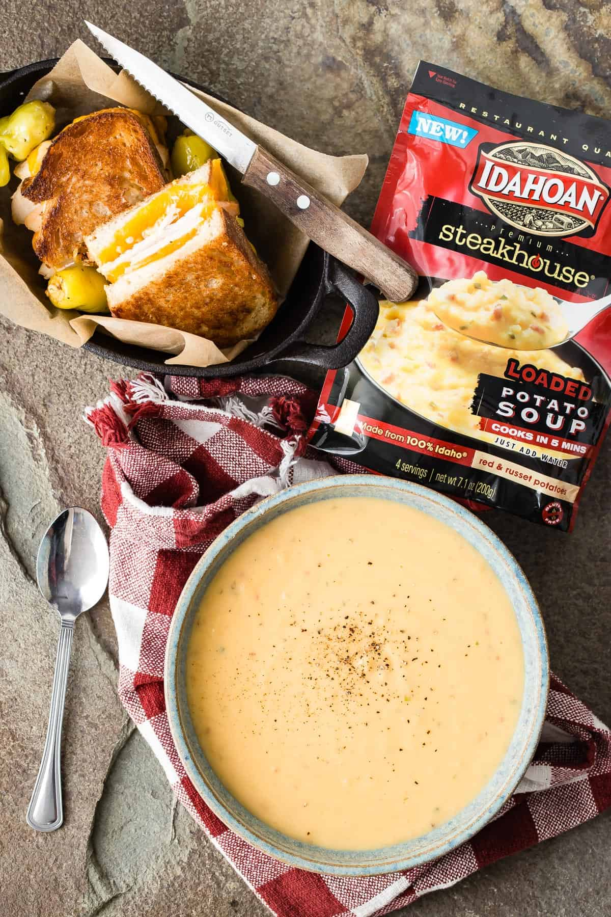 Creamy Loaded Potato Soup from Idahoan®. Full of red and russet potatoes including the skins and paired along with a turkey grilled cheese sandwich. This is the perfect lunch for the day after Thanksgiving!