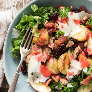 Warm kale salad with roasted potatoes, bacon, cranberries and Manchego cheese. Drizzle some super-tasty raspberry dressing on top and you'll be stuffing salads in your face all year long.