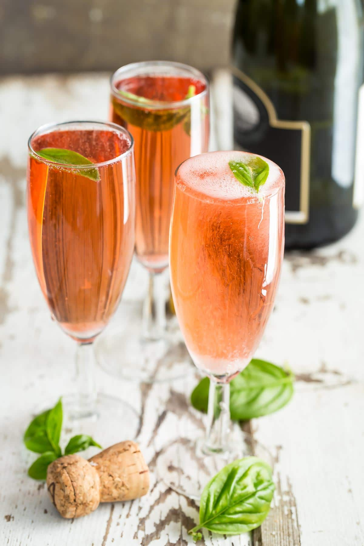 These Pomegranate Mimosas are fun and fizzy with a touch of fresh basil and triple sec. The perfect way to do brunch or celebrate the New Year!