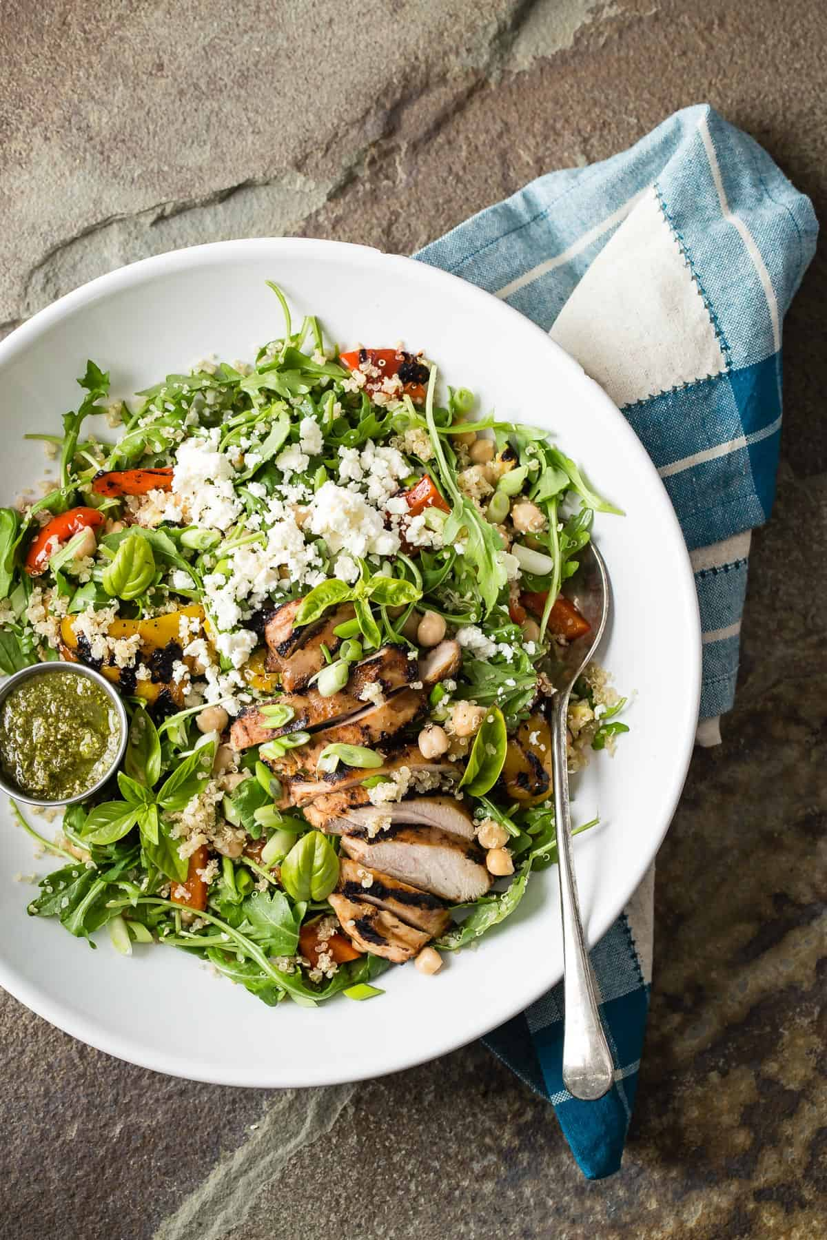 A super healthy Quinoa Vegetable Salad loaded with grilled chicken, arugula, grilled veggies, garbanzo beans and feta cheese.