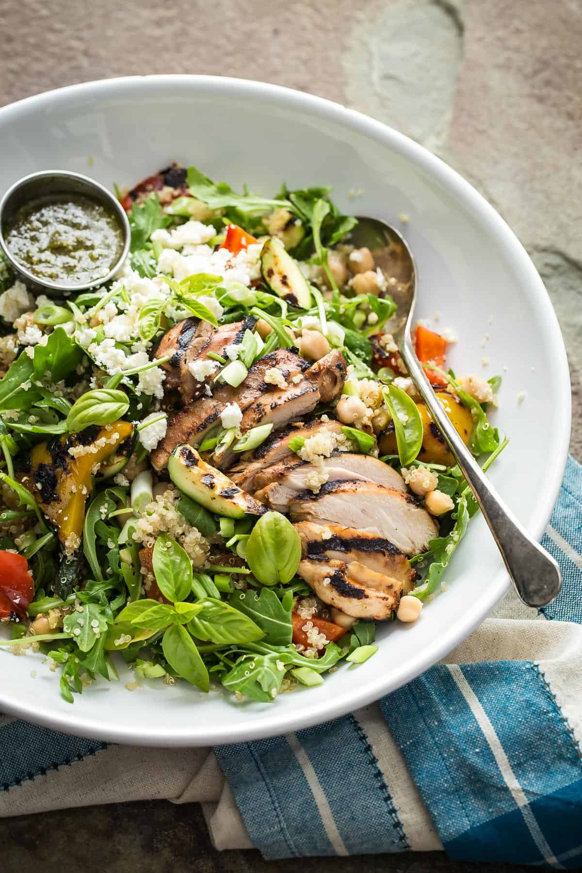 A super healthy Quinoa Vegetable Salad loaded with grilled chicken, arugula, grilled veggies, garbanzo beans and feta cheese. This should be on your New Year's resolutions menu!