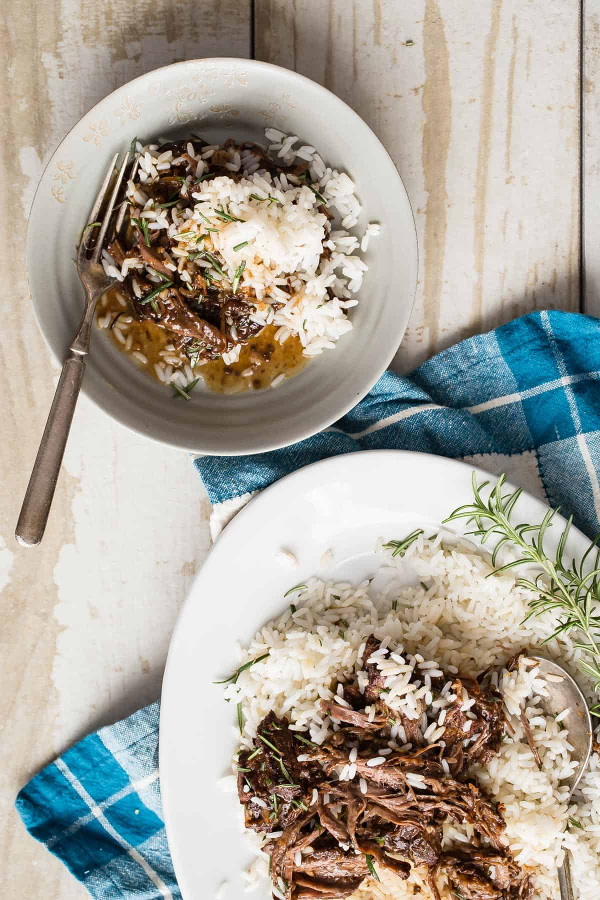 This Slow Cooker Shredded Orange Beef is so tender it might just melt in your mouth. Cooked long and slow with orange juice, beef stock and blackberry preserves, it's sure to please anyone in the family.