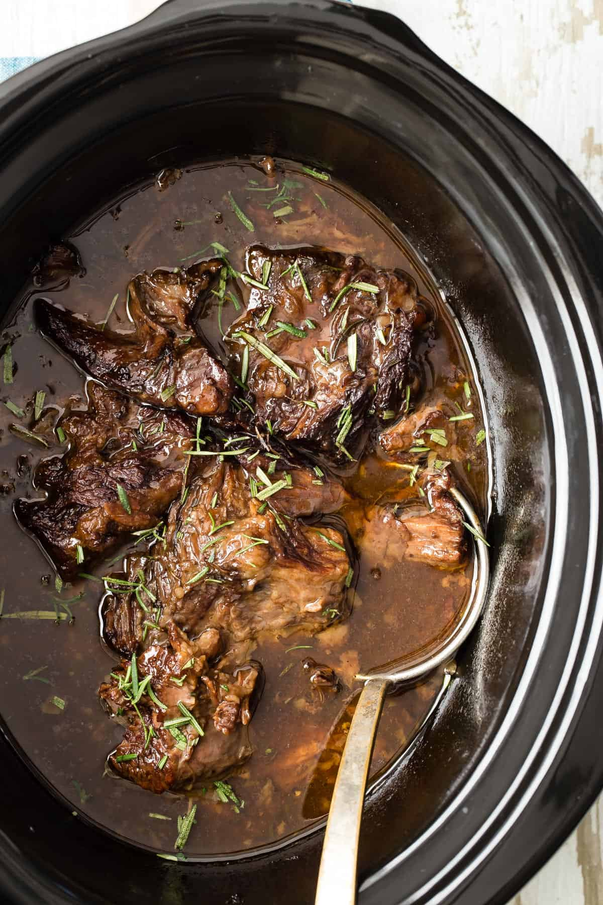 This Slow Cooker Shredded Orange Beef is so tender it might just melt in your mouth. With orange juice, blackberry preserves and beef stock.