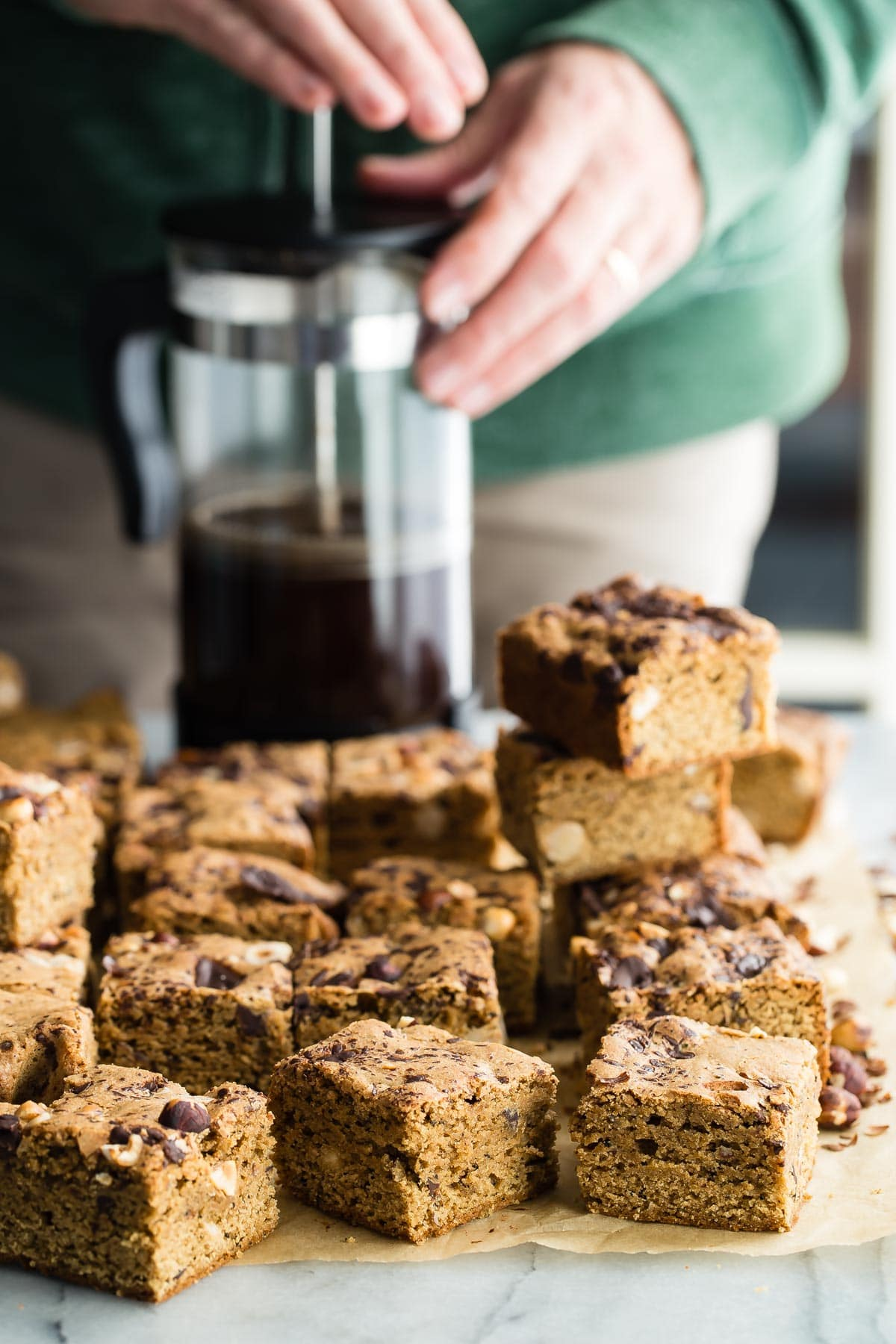 Espresso Blondies with chocolate chunks and toasted hazelnuts. Easy to make and a nice change from traditional brownies.