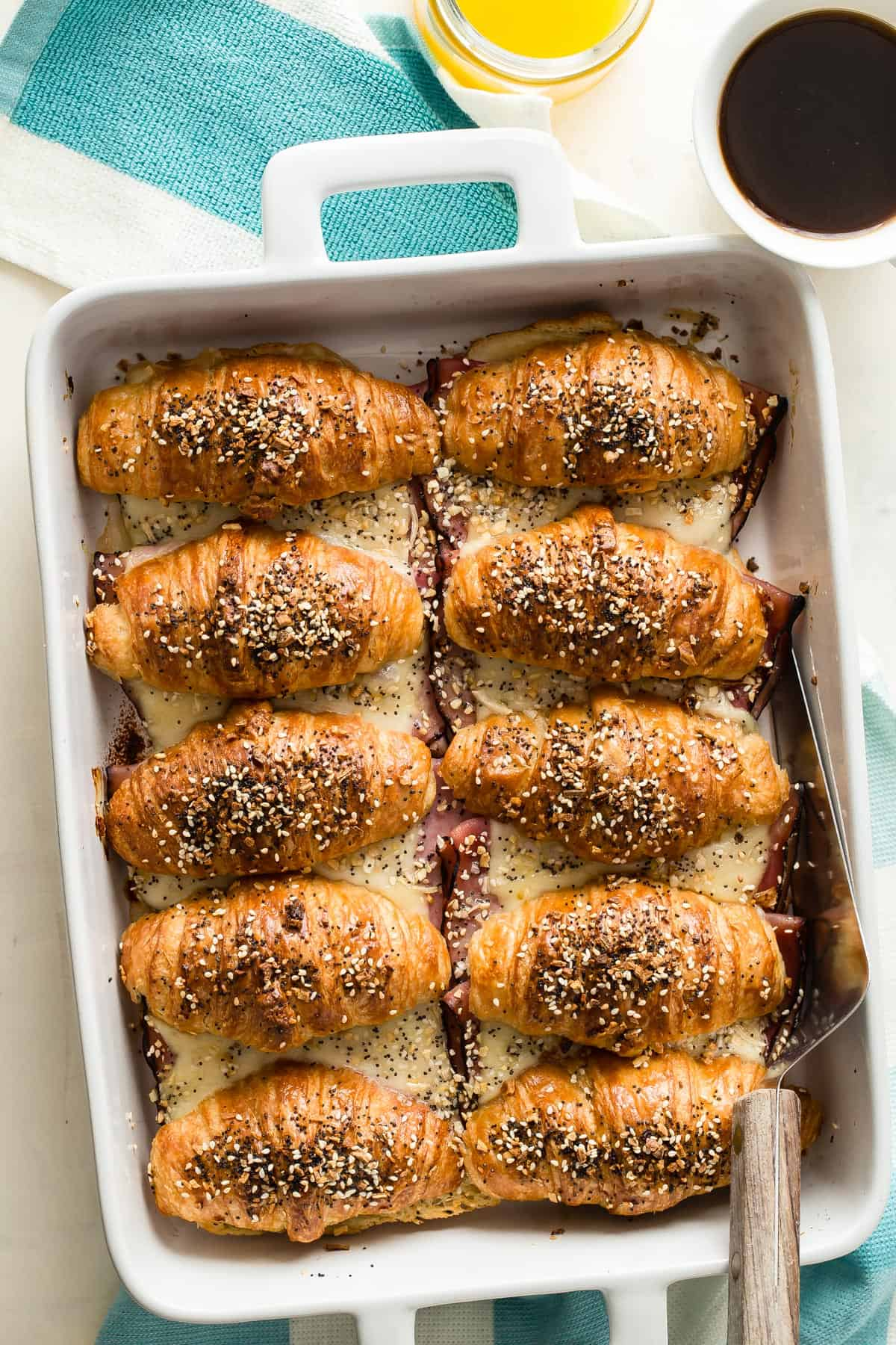 Ham and Cheese Croissants topped with everything bagel seed is how to do breakfast! These are so easy to make and will be gone from the dish in a hot second.