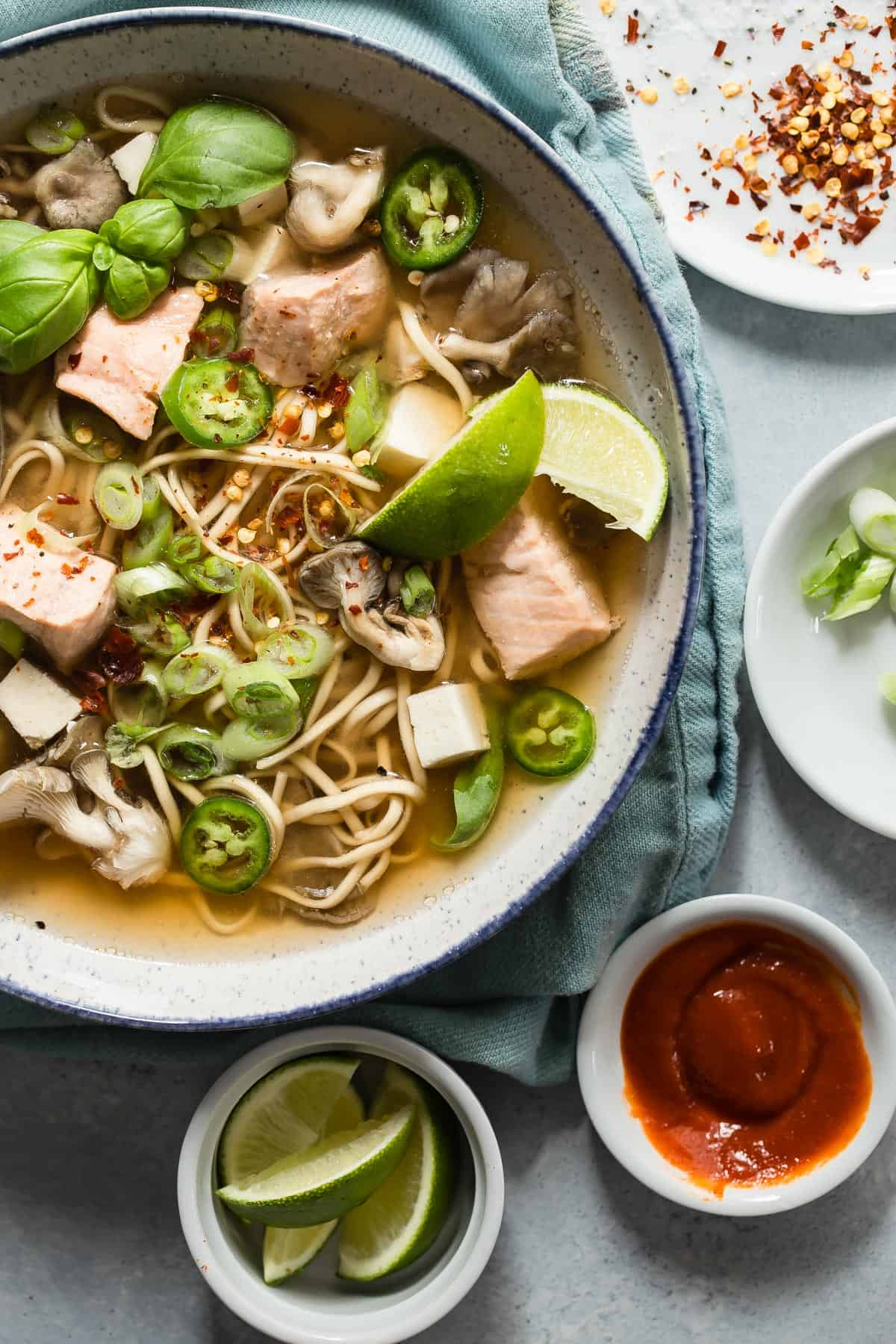 Chunks of poached salmon in a spicy miso paste broth and egg noodles. This is just like takeout only with way more attitude and bite to it!