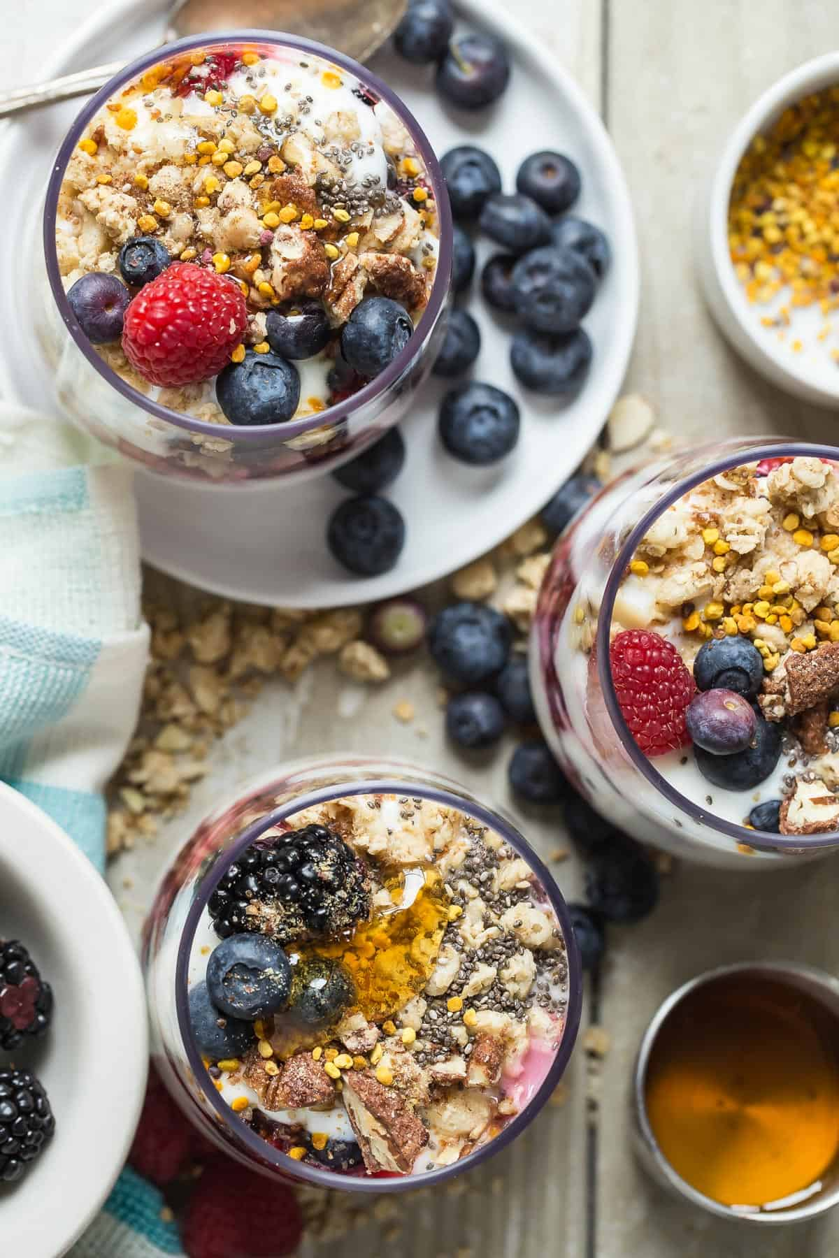 This might be the perfect and easiest way to start your day! Triple Berry Parfaits full of blueberries, raspberries and blackberries plus granola and healthy toppings.