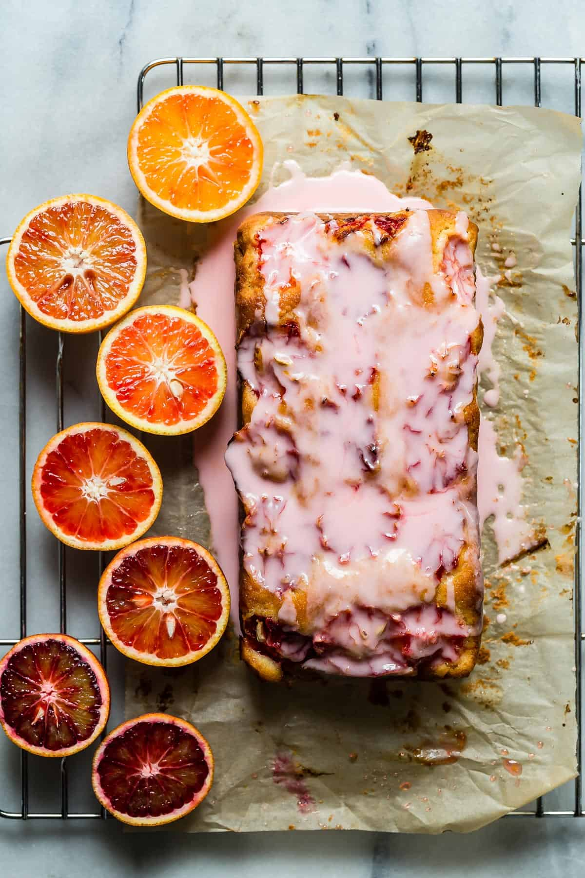 A citrus packed blood orange loaf cake topped with a tart blood orange icing. Serve a slice with a cup of your favorite tea!!