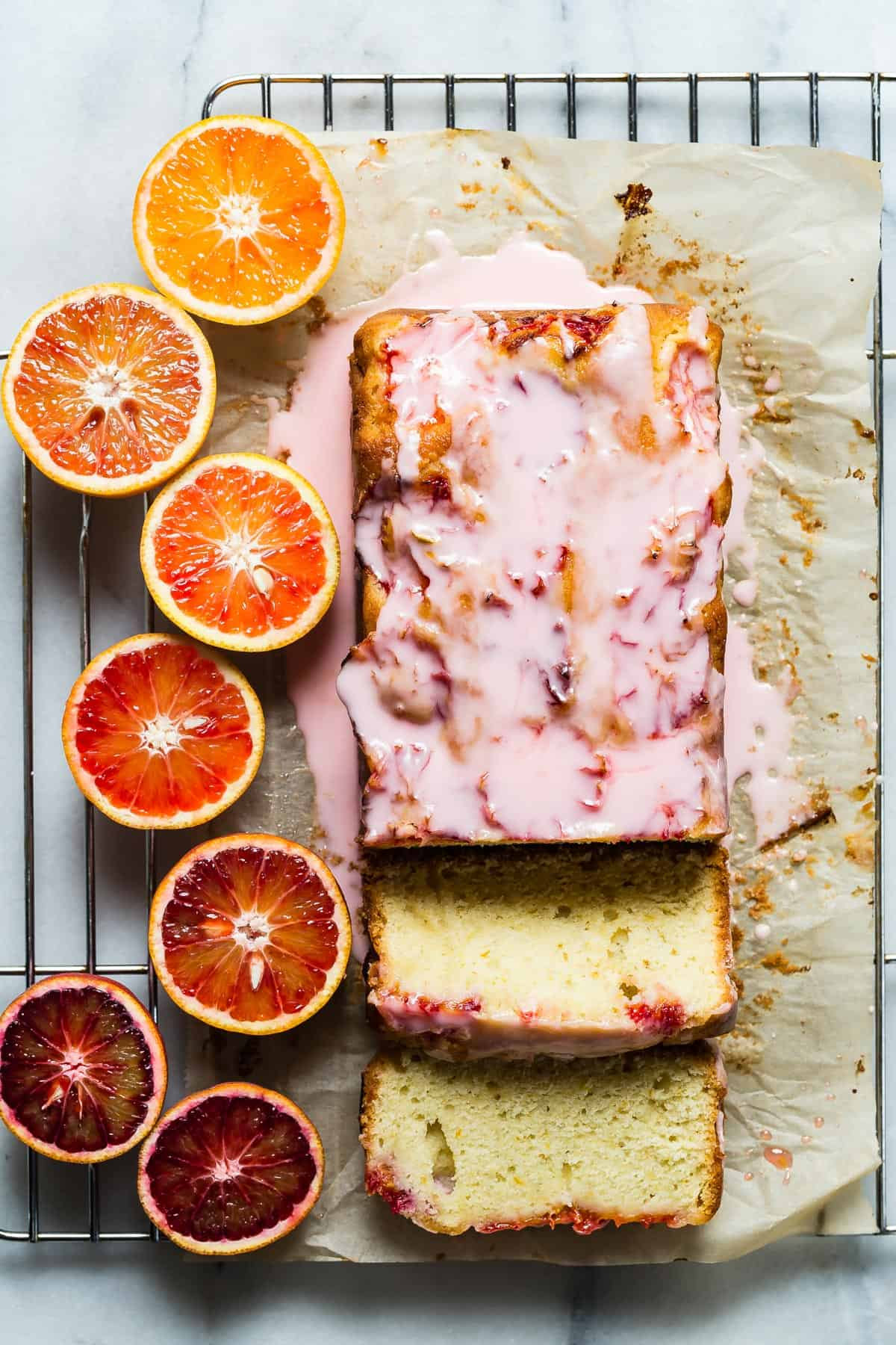 A citrus packed blood orange loaf cake topped with a tart blood orange icing. Serve a slice with a cup of your favorite tea and start dreaming about summer!