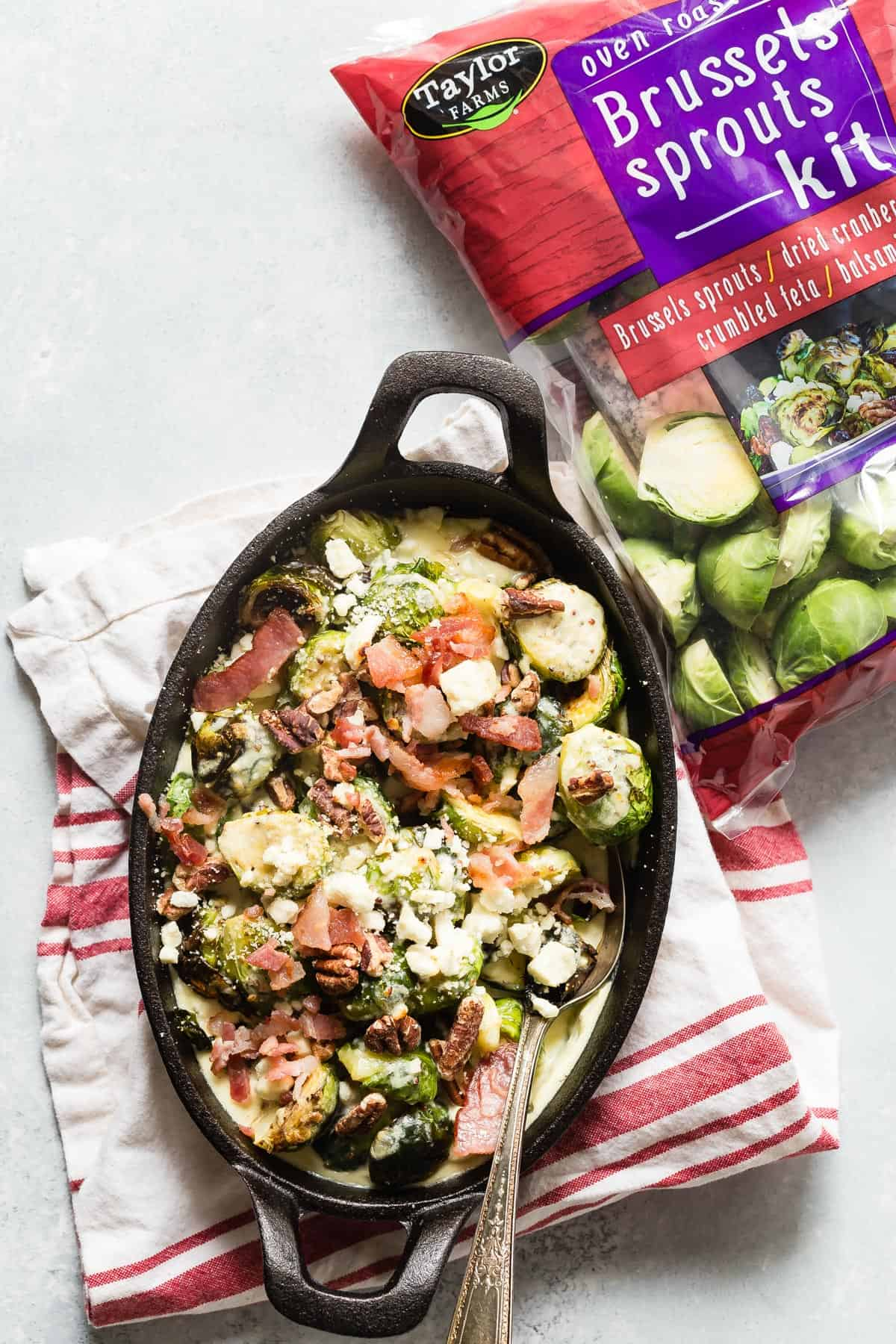 Crispy Roasted Brussels Sprouts Gratin with chunks of crispy bacon, feta cheese and balsamic vinegar. This creamy side dish will work well beside any main course!