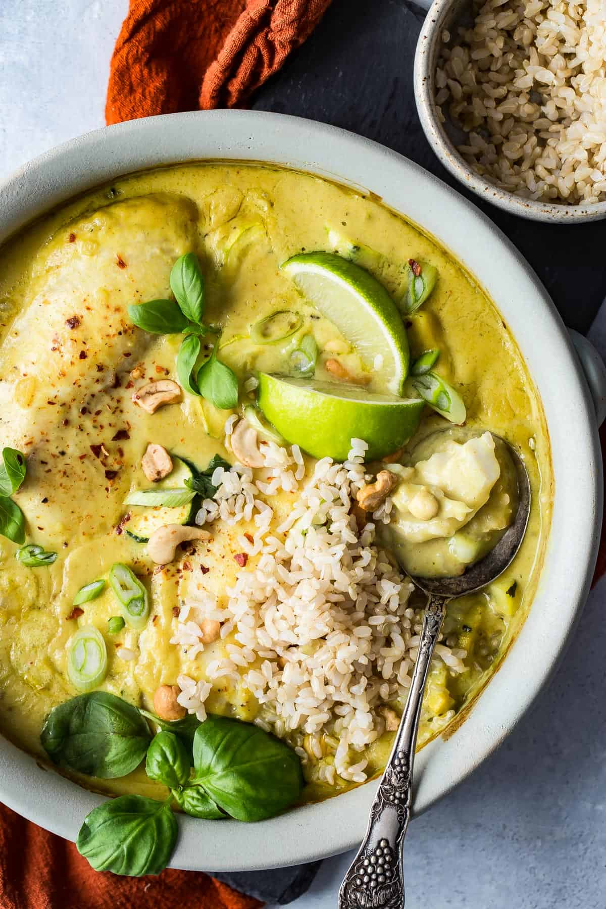 Thai style green curry sauce and fresh tilapia filets baked in creamy coconut milk and served with brown rice. Better than takeout!!
