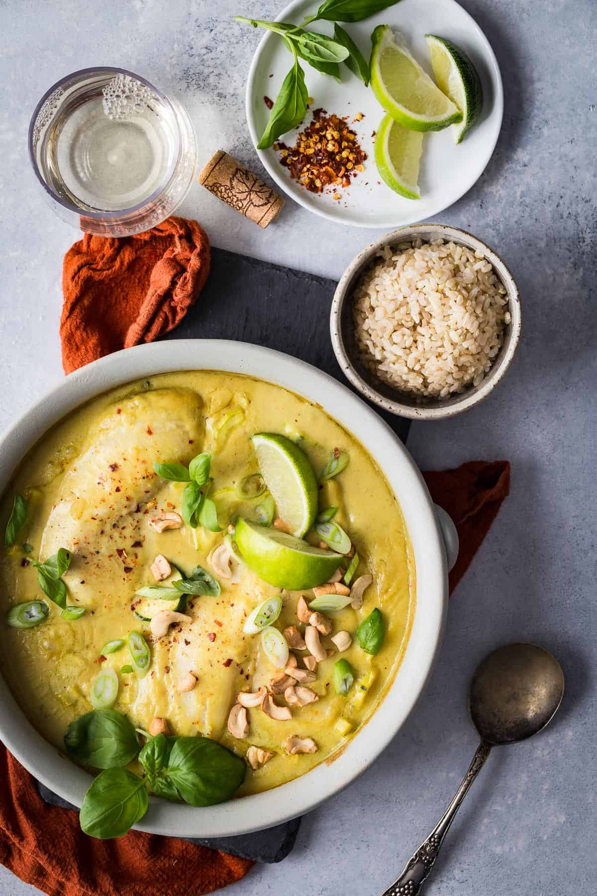 Thai style green curry sauce and fresh tilapia filets baked in creamy coconut milk and served with brown rice. Easy to make and just like your favorite takeout!
