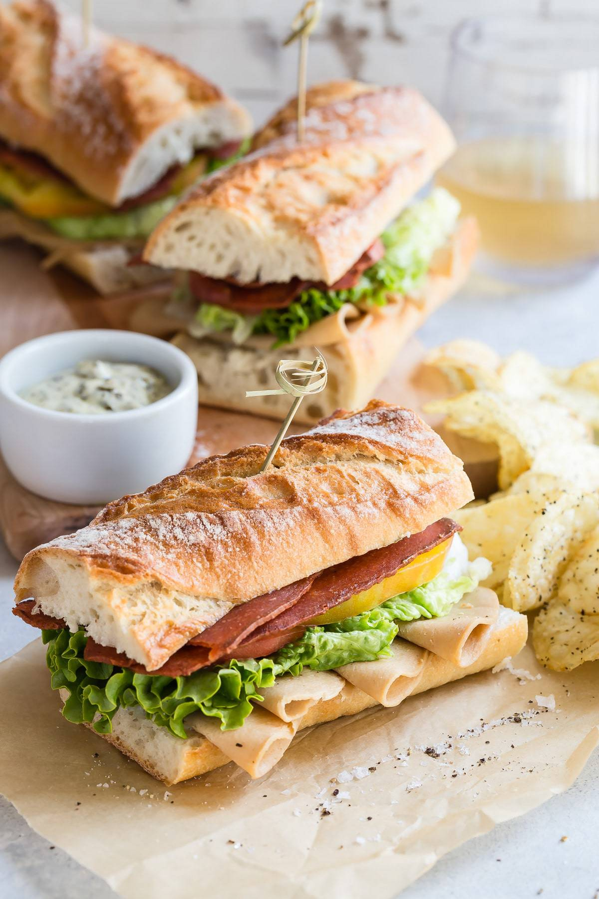 A traditional club sandwich with vegetarian bacon and turkey.